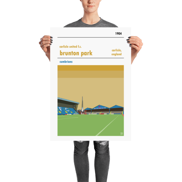 A football poster of Carlisle United and Brunton Park